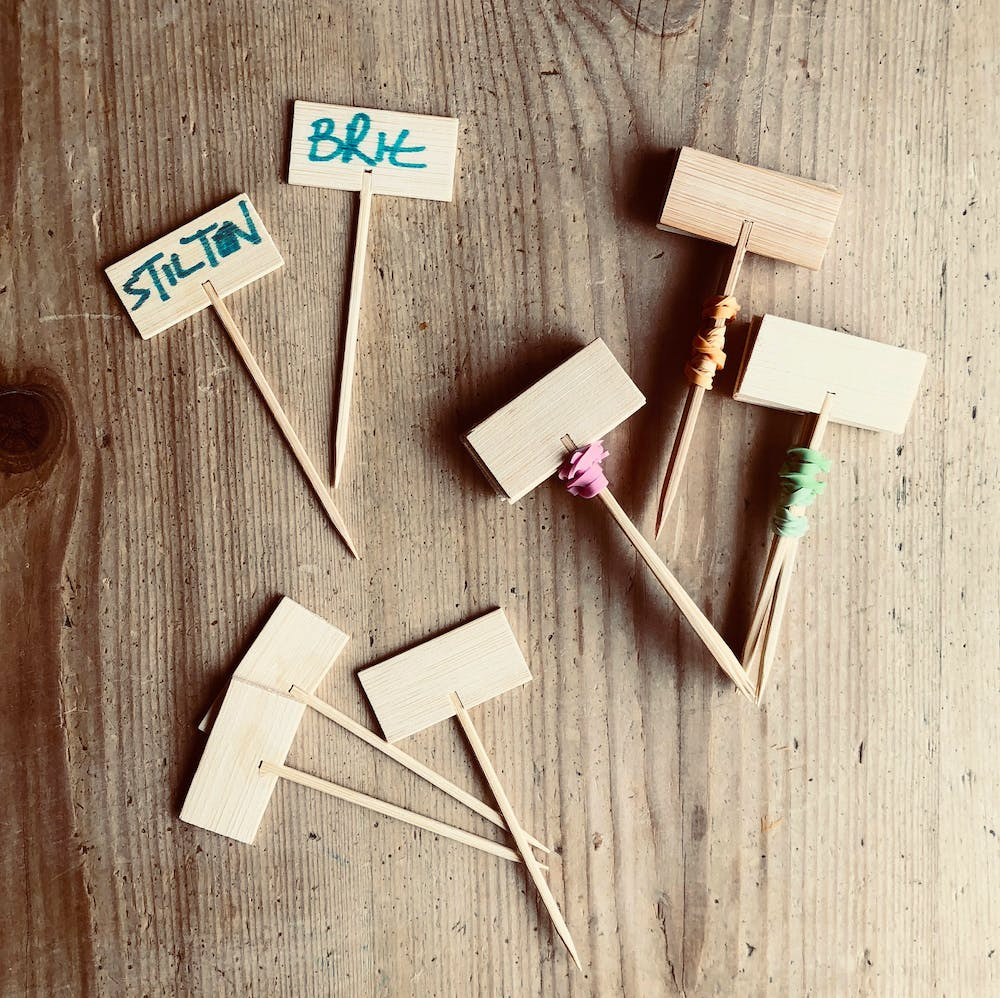 Unique little wooden cheese markers