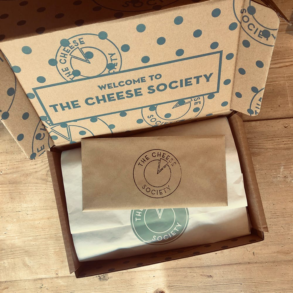 OPEN-CHEESE-BOX-DELIVERY
